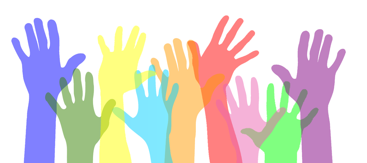 Colourful hands raised